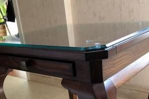 实木餐桌是否需要配一块